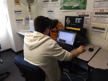 Student working on his laptop