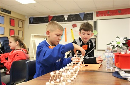 Cartmell students assemble marshmallow bridge.